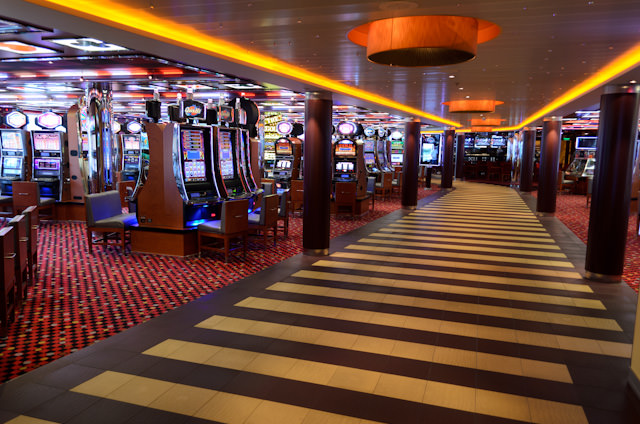 Having so much of the ship to myself gave me an excellent opportunity to photograph some of the typically-busier public spaces. Shown here is the entrance to the Casino, looking aft. Photo © 2014 Aaron Saunders