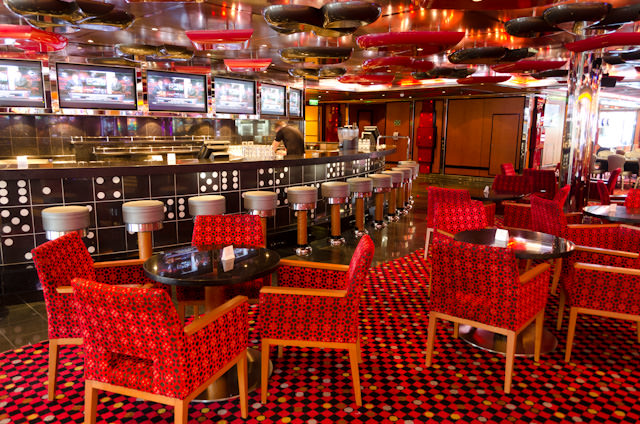 The Casino Bar on Deck 5 is one of the most popular bars onboard. An empty chair is a rarity. Photo © 2014 Aaron Saunders