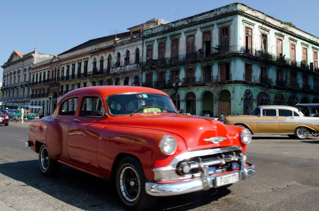 Classic cars race along the streets of Havana, Cuba. Photo © 2014 Aaron Saunders