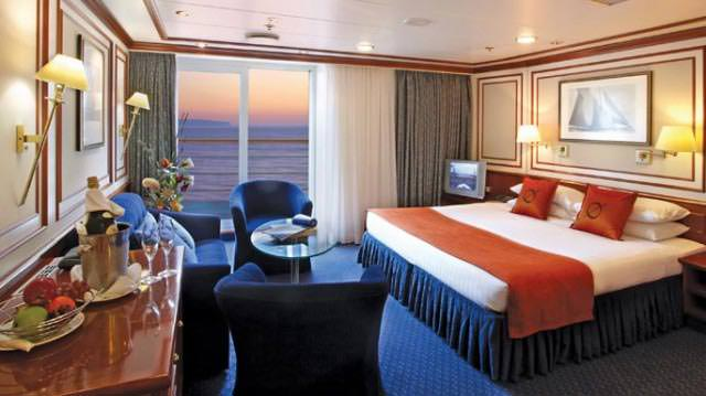 National Geographic Orion's Category 6 suites on the Bridge Deck feature beautifully appointed bedrooms and separate living rooms, plus sliding glass doors that open onto French balconies. © 2014 Lindblad Expeditions - National Geographic
