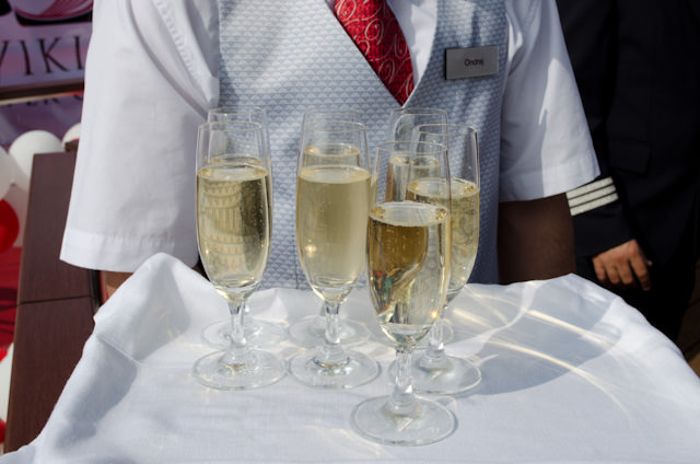 Champagne: never christen a ship without it! Photo © 2014 Aaron Saunders