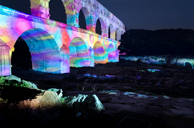 Psychedelic colours projected onto Pont Du Gard. Photo © 2014 Aaron Saunders