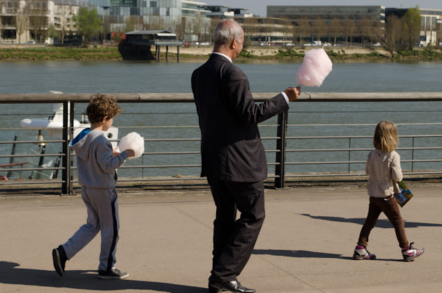 Out and About in Bordeaux. Passers-by enjoy cotton candy from a nearby carnival. Photo © 2014 Aaron Saunders