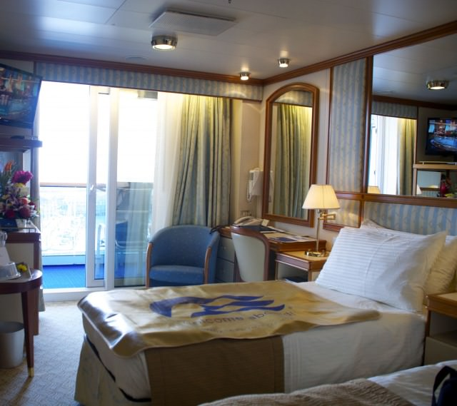 Our Aloha Deck balcony stateroom allows us to have one queen or two twin beds. © 2014 Gail Jessen
