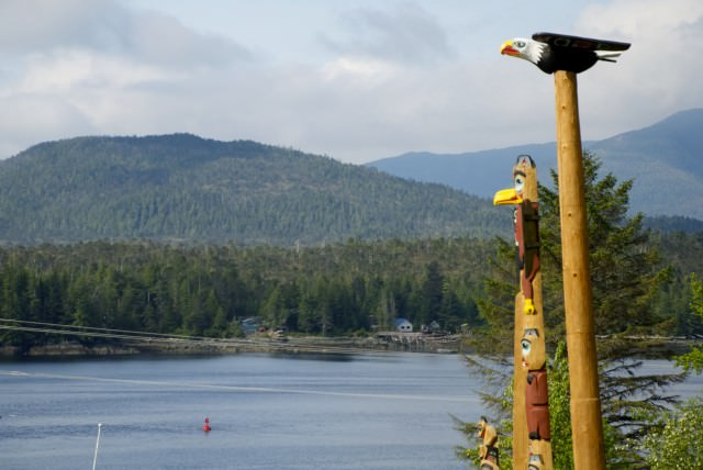 Totem poles in Saxman Village keep a watchful eye on the Tongass Narrows. © 2014 Gail Jessen
