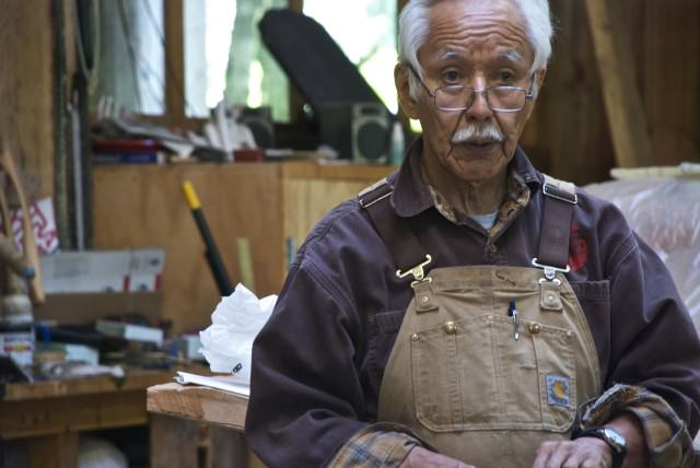 "Tlingit master carver Nathan Jackson. Apprentice carvers can earn up to $1,000 per foot of their work. Experienced carvers earn up to $5,000 per foot. Master Carvers ""can basically charge whatever they want and people will pay,"" as we were told. © 2014 Gail Jessen"