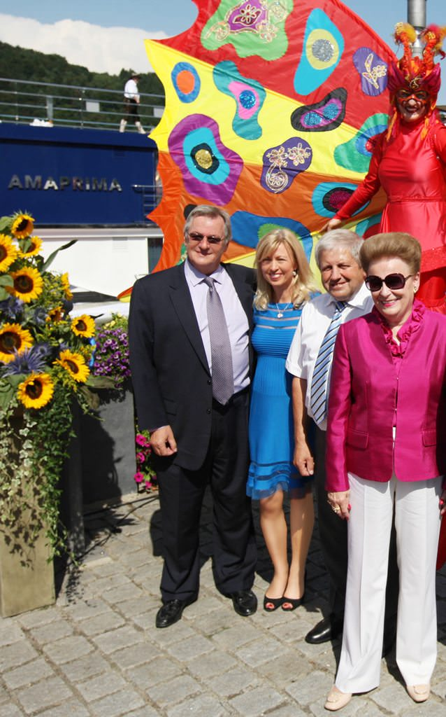 From left, Rudi Schreiner, AmaWaterways' president, and Kristin Karst, executive vice president, photographed during a Bavarian christening ceremony of their new ship AmaPrima in Vilshofen, Germany. Also pictured AmaPrima godmother Valerie Wilson (far right). © 2013 Ralph Grizzle