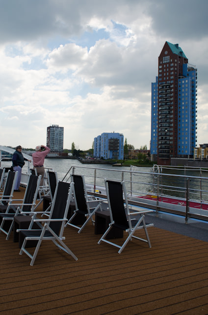 Departure from Rotterdam. Throughout the city, colourful buildings line the harbour. Photo © 2014 Aaron Saunders