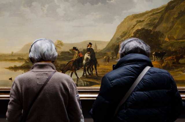 A couple admires Aelbert Cuyp's 'River Landscapes with Riders (1653-57) Photo © 2014 Aaron Saunders