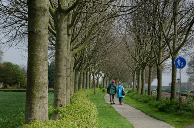 Back in Veere, a couple from the Inspire strolls along a picturesque pedestrian path. Photo © 2014 Aaron Saunders