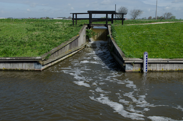 A system of polders, drained by windmills (and today, modern pumping stations) keeps the water from flooding the Netherlands, much of which resides below sea level.