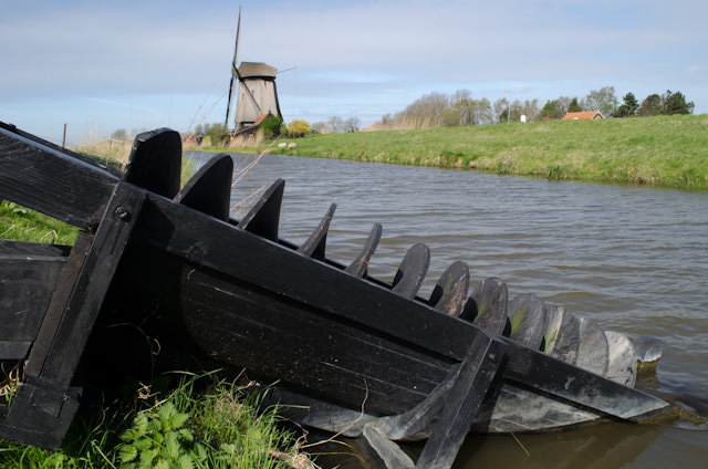 Screws like this one are driven by the wind mill itself. They in turn raise the water up and divert it out the other side of the windmill, into another polder, or stream. Photo © 2014 Aaron Saunders