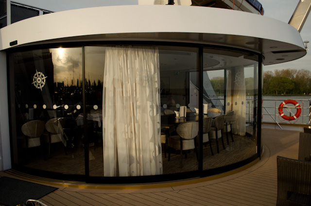 The ms Inspire's alternate dining venue, Arthur's, is located all the way aft on Deck 3 and features gorgeous floor-to-ceiling windows overlooking the stern of the ship. Outdoor seating is also available in the right weather conditions. Photo © 2014 Aaron Saunders