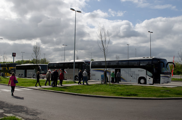 Heading back to the coaches after a quick pit-stop en-route to Brussels. Photo © 2014 Aaron Saunders