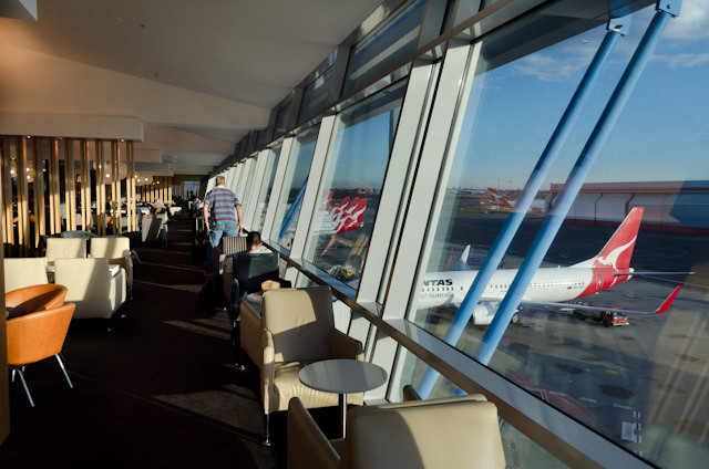 Large oversized windows let plenty of light into the Business Lounge at T3. Photo © 2014 Aaron Saunders