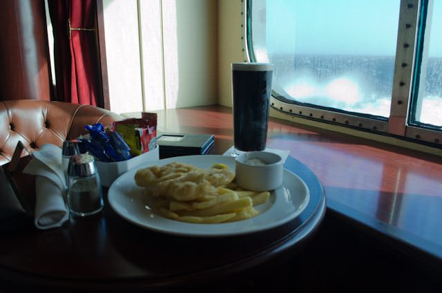 Fish, chips, Guinness in the Golden Lion Pub aboard Queen Mary 2. Photo © 2012 Aaron Saunders