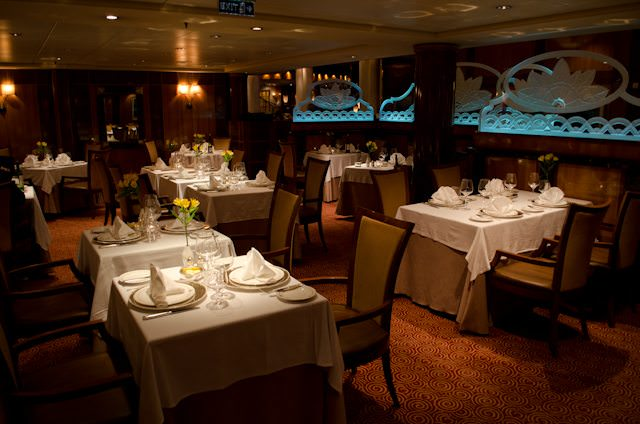 The intimate Britannia Club Restaurant aboard Queen Mary 2. Photo © 2012 Aaron Saunders