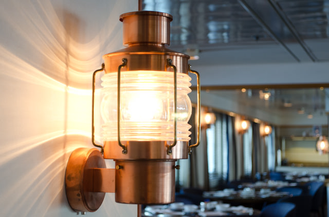 While the decor in the Silver Discoverer lounge isn't terribly 'Silversea', these nautical lamps in the Discoverer Lounge are a nice touch. Photo © 2014 Aaron Saunders