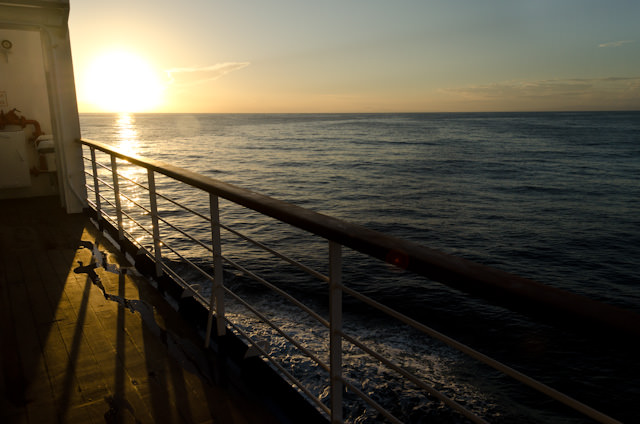 Silver Discoverer sails into the sunset as she makes her way towards Bali, Indonesia, where I will disembark tomorrow. Photo © 2014 Aaron Saunders