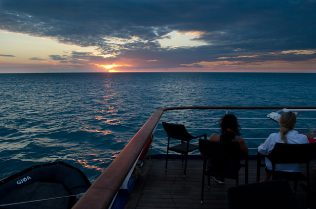 Guests take in the spectacular sunset off the coast of Western Australia aboard Silversea's Silver Discoverer. Photo © 2014 Aaron Saunders