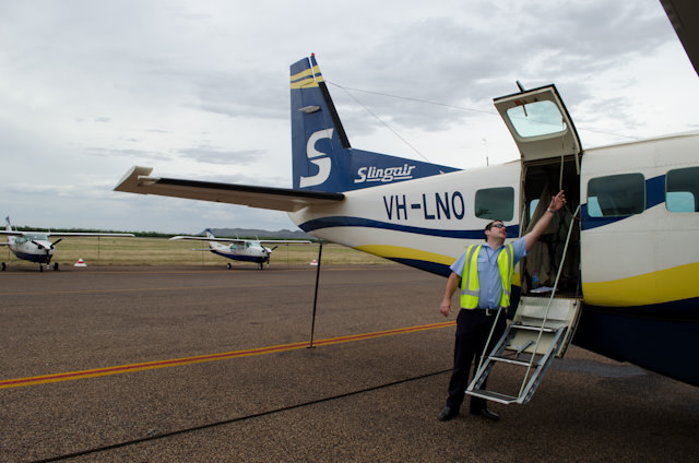 Our Pilot demonstrates how to use the rear emergency exit in the event of an emergency. Photo © 2014 Aaron Saunders