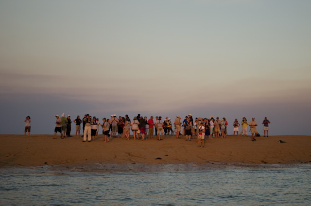 Silver Discoverer guests atop a sand bar, surrounded by ocean. Photo © 2014 Aaron Saunders