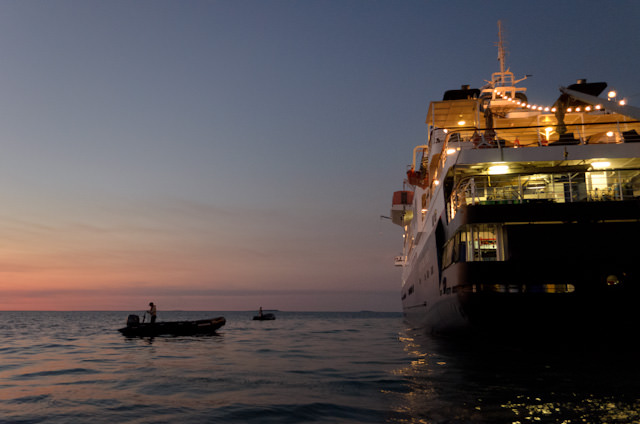 Zodiacs return to the Silver Discoverer as the last rays of light fill the coast of Australia's Kimberley region. Photo © 2014 Aaron Saunders