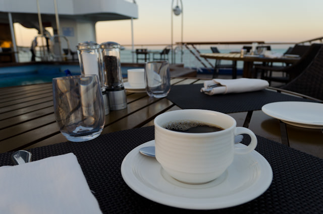 Enjoying a fresh cup of coffee out on the aft portion of Deck 5 aboard Silver Discoverer. Photo © 2014 Aaron Saunders