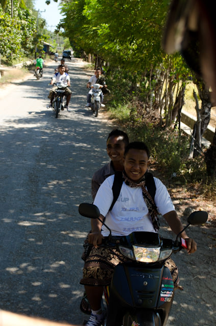 Locals followed along with our little truck procession to the next village. Photo © 2014 Aaron Saunders