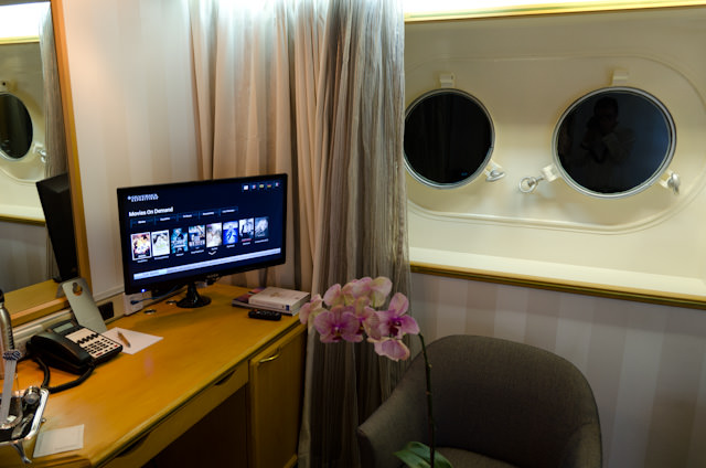 Portholes, sitting area and a desk with an interactive television. Photo © 2014 Aaron Saunders
