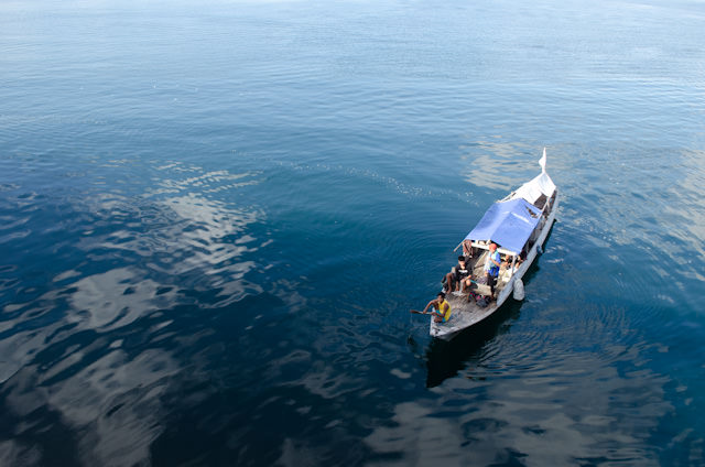 Local vendors sailed and paddled out to the Silver Discoverer to sell their wares. Photo © 2014 Aaron Saunders