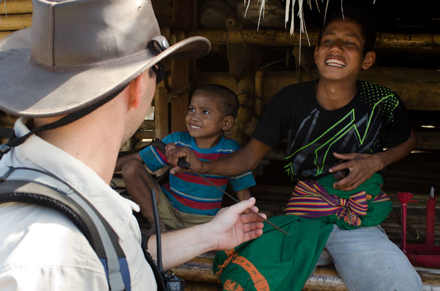 A local boy shows Expedition Team member Juan his sword. It's not a toy... Photo © 2014 Aaron Saunders