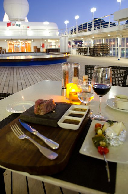 Silversea ships all boast Poolside Dining featuring 'hot rock' grilling under the stars. Photo © 2013 Aaron Saunders