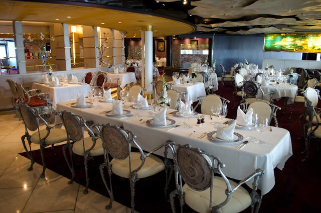 The Pinnacle Grill aboard Holland America's Zuiderdam. Note the custom-designed chairs and location just off the ship's atrium. Photo © 2012 Aaron Saunders