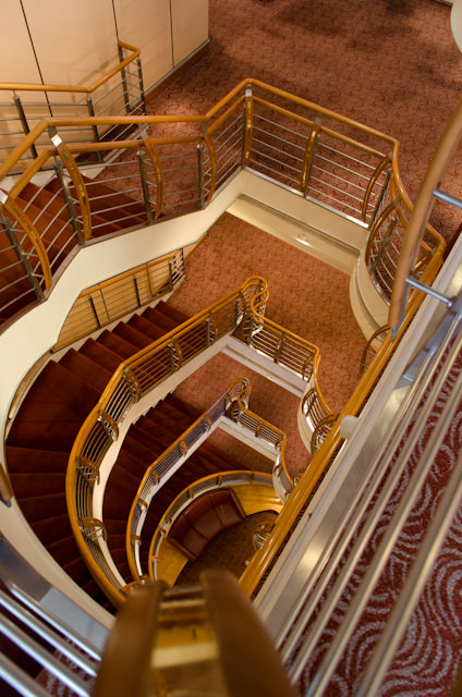 Looking down one of two identical staircases aboard Silversea's Silver Shadow. Photo © 2014 Aaron Saunders