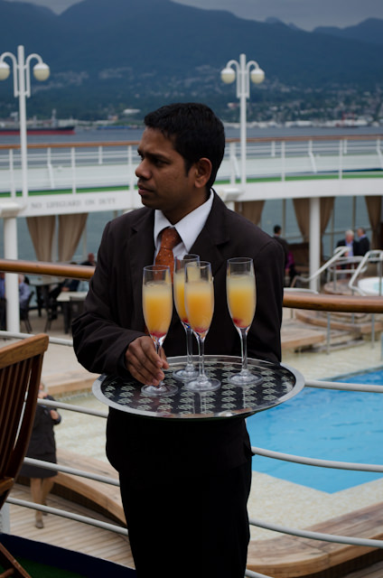 Welcome Aboard! The skies may be overcast, but the pool drinks are flowing. Complimentary, no less - nearly everything is included on Silversea. Photo © 2014 Aaron Saunders