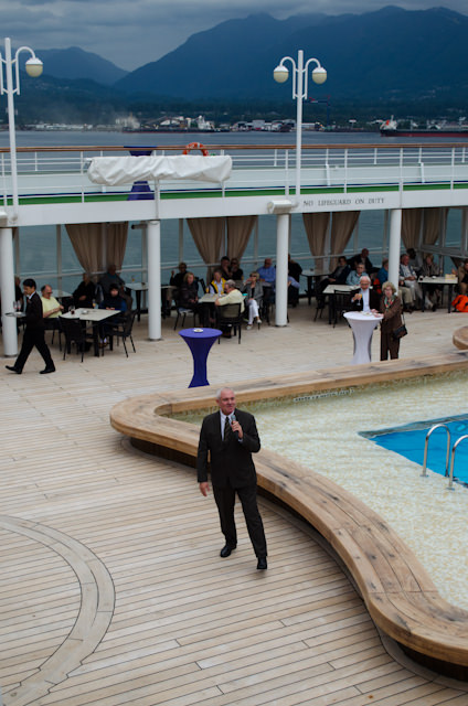 Silver Shadow Cruise Director Don Fluke leads the departure celebrations on the Pool Deck. Photo © 2014 Aaron Saunders