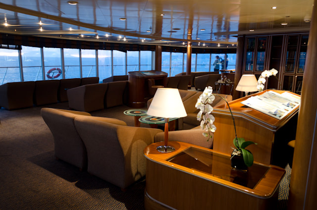 Admiring the view from the forward-facing Observation Lounge situated high atop Deck 10 aboard Silversea's Silver Shadow. Photo © 2014 Aaron Saunders