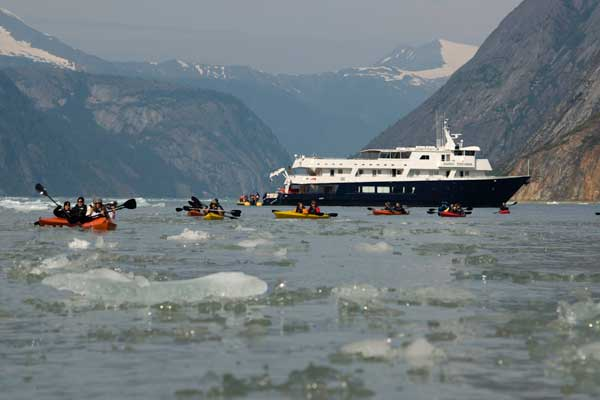 Guests in Alaska can enjoy beachcombing, hiking, or even kayaking with Un-Cruise. Photo courtesy of Un-Cruise Adventures.