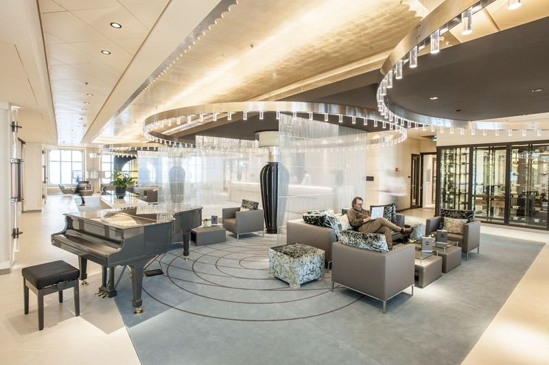 EUROPA 2's interiors are elegant and modern. Shown here is the Reception Lobby on Deck 4. Photo courtesy of Hapag-Lloyd Cruises