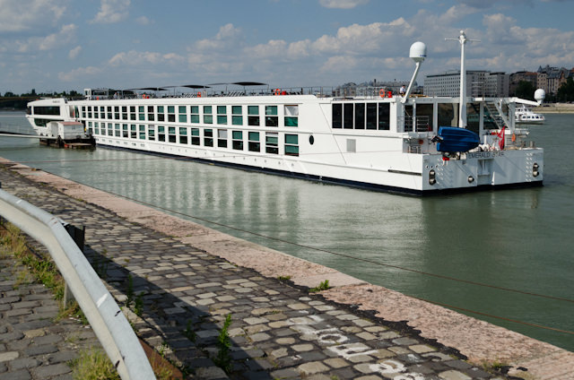 Setting out to explore Budapest! Emerald Star is seen here at her berth. The Pool occupies the tinted windows at the stern. Photo © 2014 Aaron Saunders