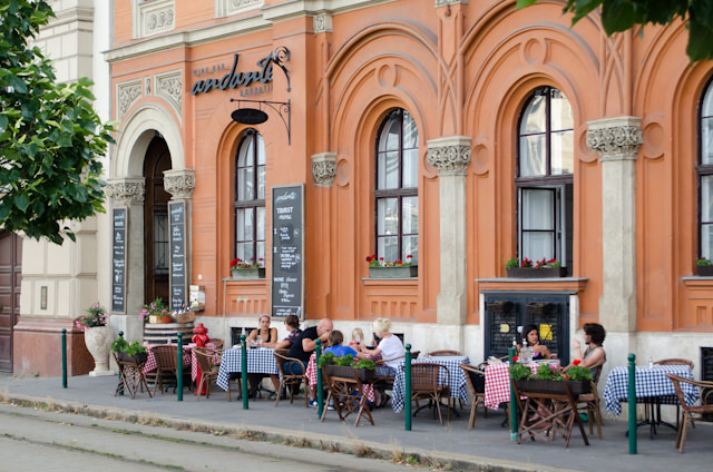 Locals enjoying a meal outdoors in Budapest. Photo © 2014 Aaron Saunders