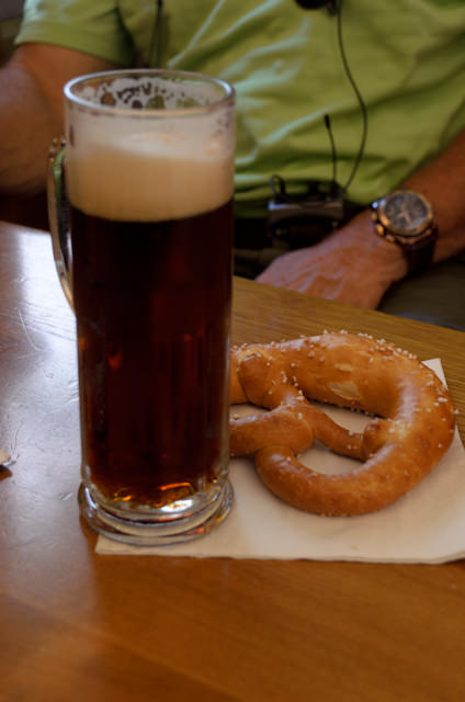 "Enjoying a traditional Bavarian beer - reportedly the oldest operating Monastic brewery - and a fresh ""bretzel."" Photo © 2014 Aaron Saunders"
