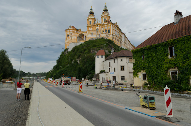 Stift Melk - or Melk Abbey - lords over the town of Melk. It's seen here later in the day, along with an unusual amount of road work. Photo © 2014 Aaron Saunders