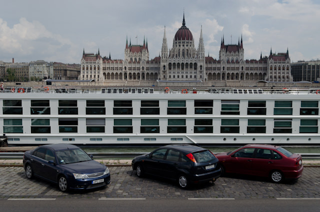 Departing the Emerald Star on my own walking tour of Budapest. There's an interesting contrast between our ship, the cars, and the classically-styled Parliament in the background. Photo © 2014 Aaron Saunders