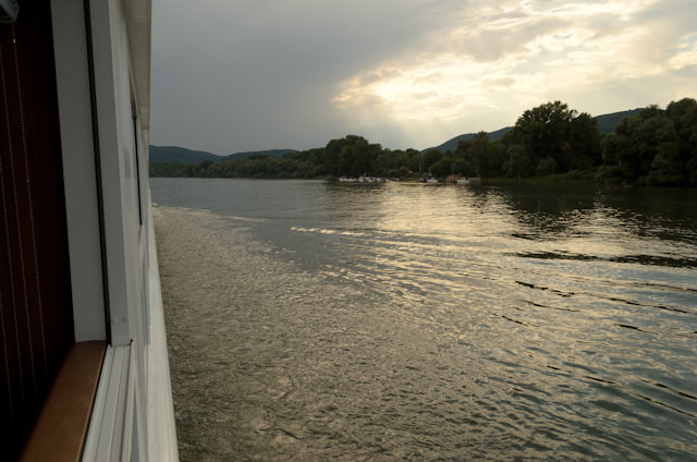 The sun sets along the Danube, as seen from my balcony. Photo © 2014 Aaron Saunders