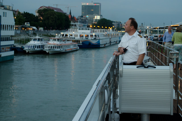 Our Captain guides Emerald Star away from Bratislava. Photo © 2014 Aaron Saunders