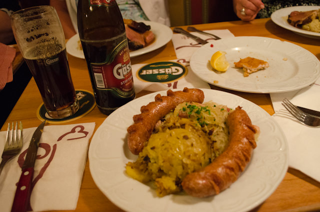 Enjoying local food - including homemade bratwurst and Austrian beer - ashore in Vienna. Photo © 2014 Aaron Saunders