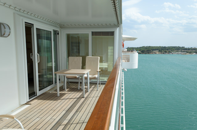 The spacious balcony of Owner's Suite 1001. Note the starboard side navigation bridge wing just forward. Photo © 2014 Aaron Saunders