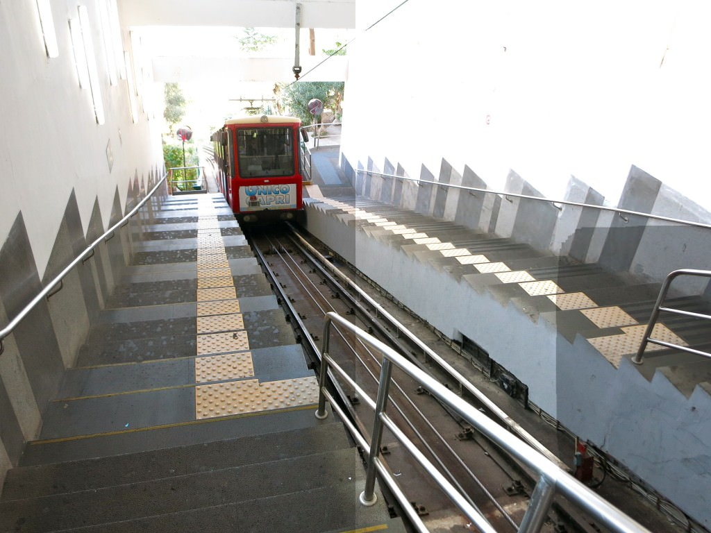 Passengers load in one side and exit out the other on Capri's funiculare.